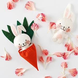 tiny rabbit softie in a carrot sleeping bag