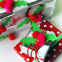 Pom pom holly gift wrap