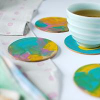 painted-coasters-closeup-600x823