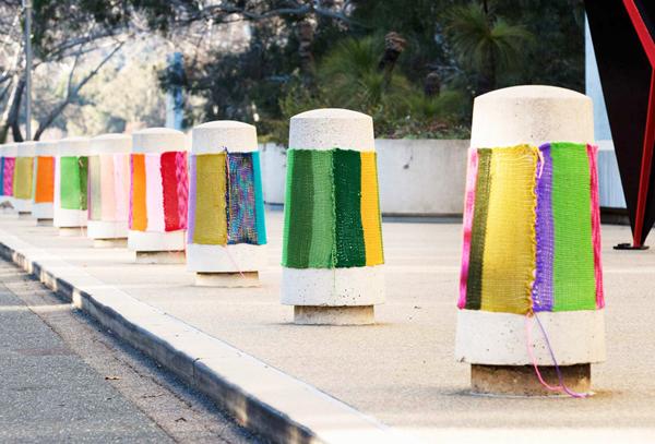 Knitta sidewalk via the red thread