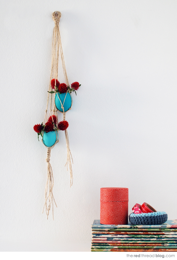 the red thread hanging egg vases