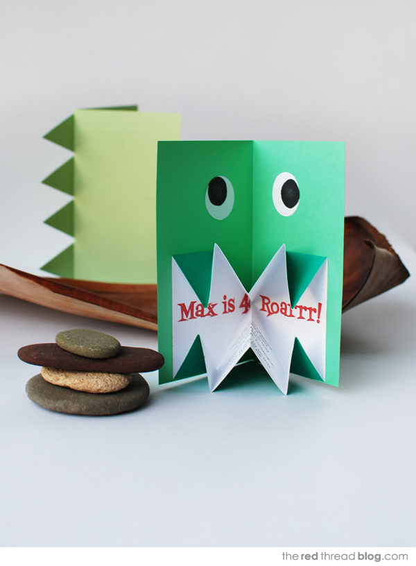 the red thread pop up origami dinosaur invite