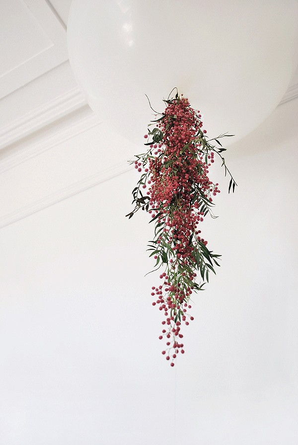 Decorate an oversized balloon with fresh trailing flowers for an instant wow table centrepice, via We-Are-Scout.com.