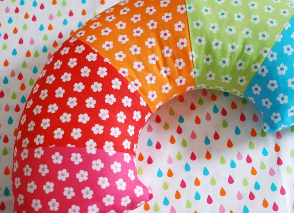 Sew a bright ranbow pillow - tutorial via We Are Scout