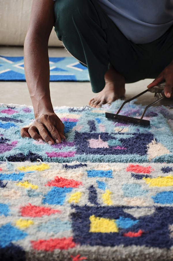 Production of Floor Story rugs in India.