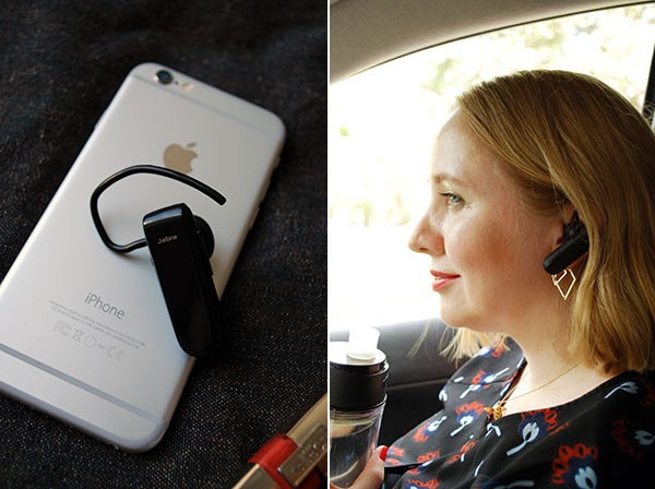Taking a call on my Jabra Classic Bluetooth Headset, while trying to keep up with my 1.5L a day. Water bottle helps - just need to remember to use it!