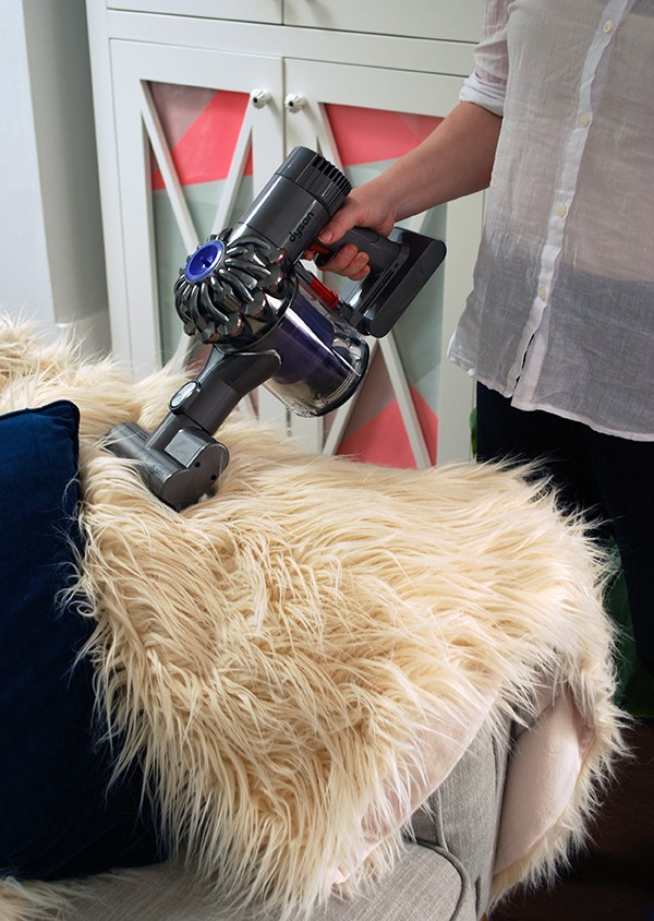 The Dyson DC54 is perfect for keeping dust mite populations under control in my fluffy throw rug.