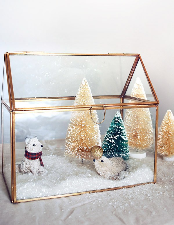 Create a mini winter wonderland with a brass house box and decorations from West Elm. Photo by Lisa Tilse for We Are Scout.