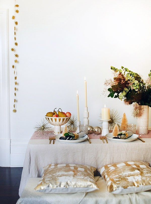 Create a mid-century inspired, soft rose gold Christmas table with West Elm. Get the how-to and top tips at We Are Scout. Photo by Lisa Tilse for We Are Scout.
