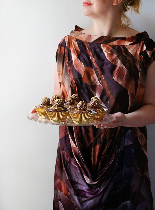 How to make Ferrero Rocher and Nutella cupcakes, dusted with gold flecks - the perfect Christmas treat. Photo by Lisa Tilse for We Are Scout.