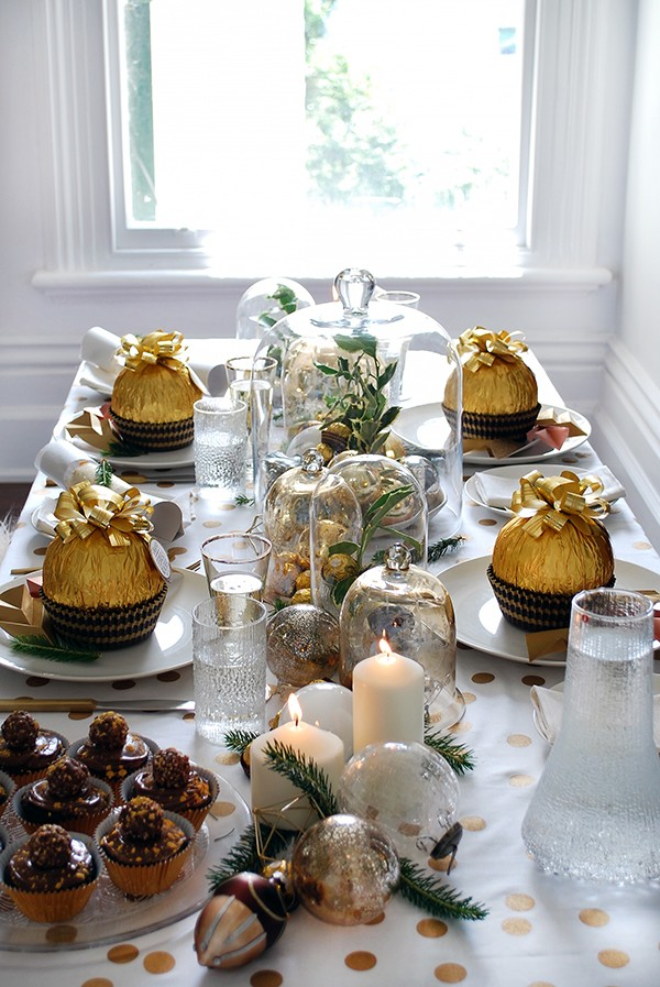 How to set a stunning Christmas table with white and gold accents, vintage glass cloches, and simple DIYS. Photo by Lisa Tilse for We Are Scout.