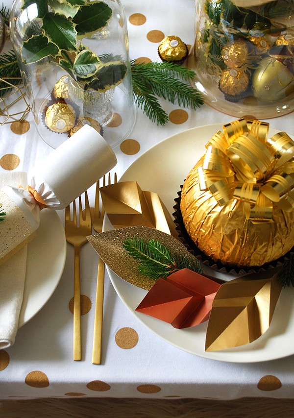 Make origami gold leaves for your Grand Ferrero Rocher place setting. Photo and craft by Lisa Tilse for We Are Scout.