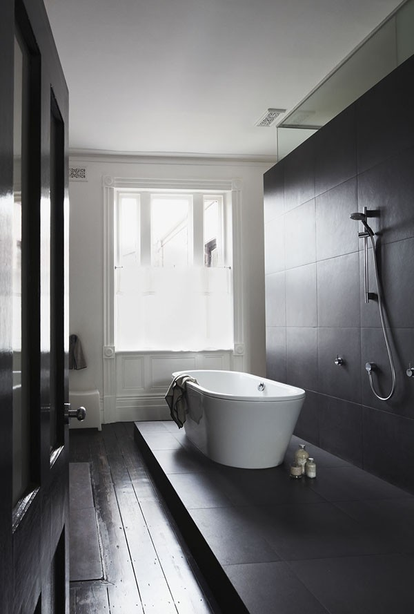 Whiting Architects - amazing black and white bathroom with raised wet area.