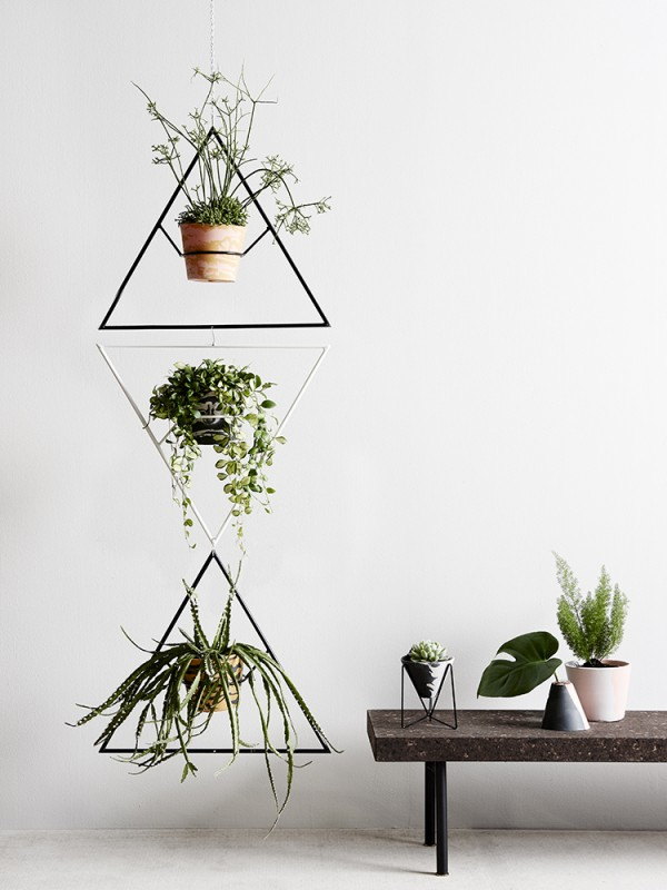 Individually crafted resin pots and modernist-inspired wire plant stands and hangers by Capra Designs.
