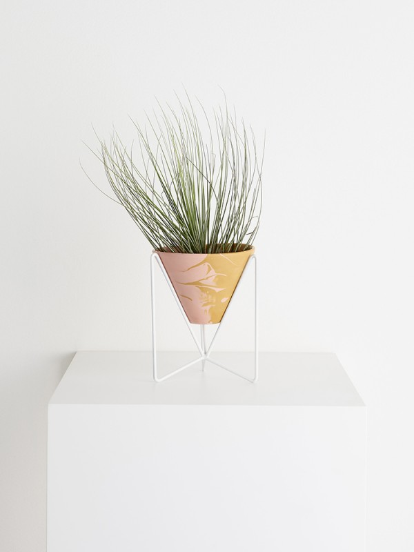 Individually crafted resin pot and modernist-inspired wire plant stand by Capra Designs.