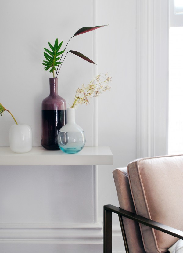 Glass vessels and pink chair from West Elm