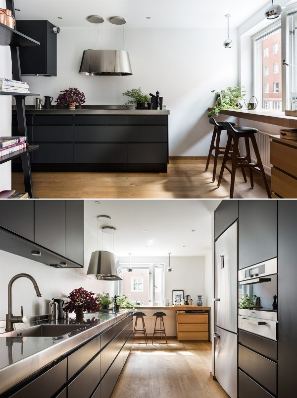 An elegant black kitchen with cafe-style dining area