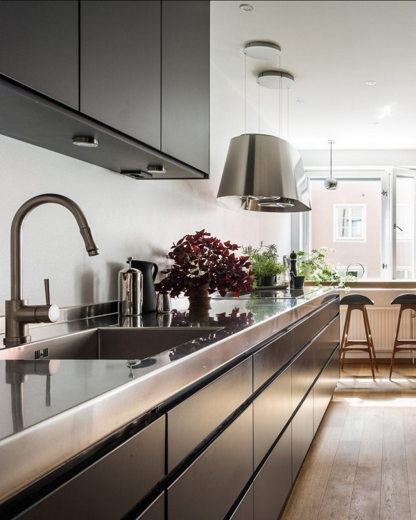 An elegant black eat-in kitchen