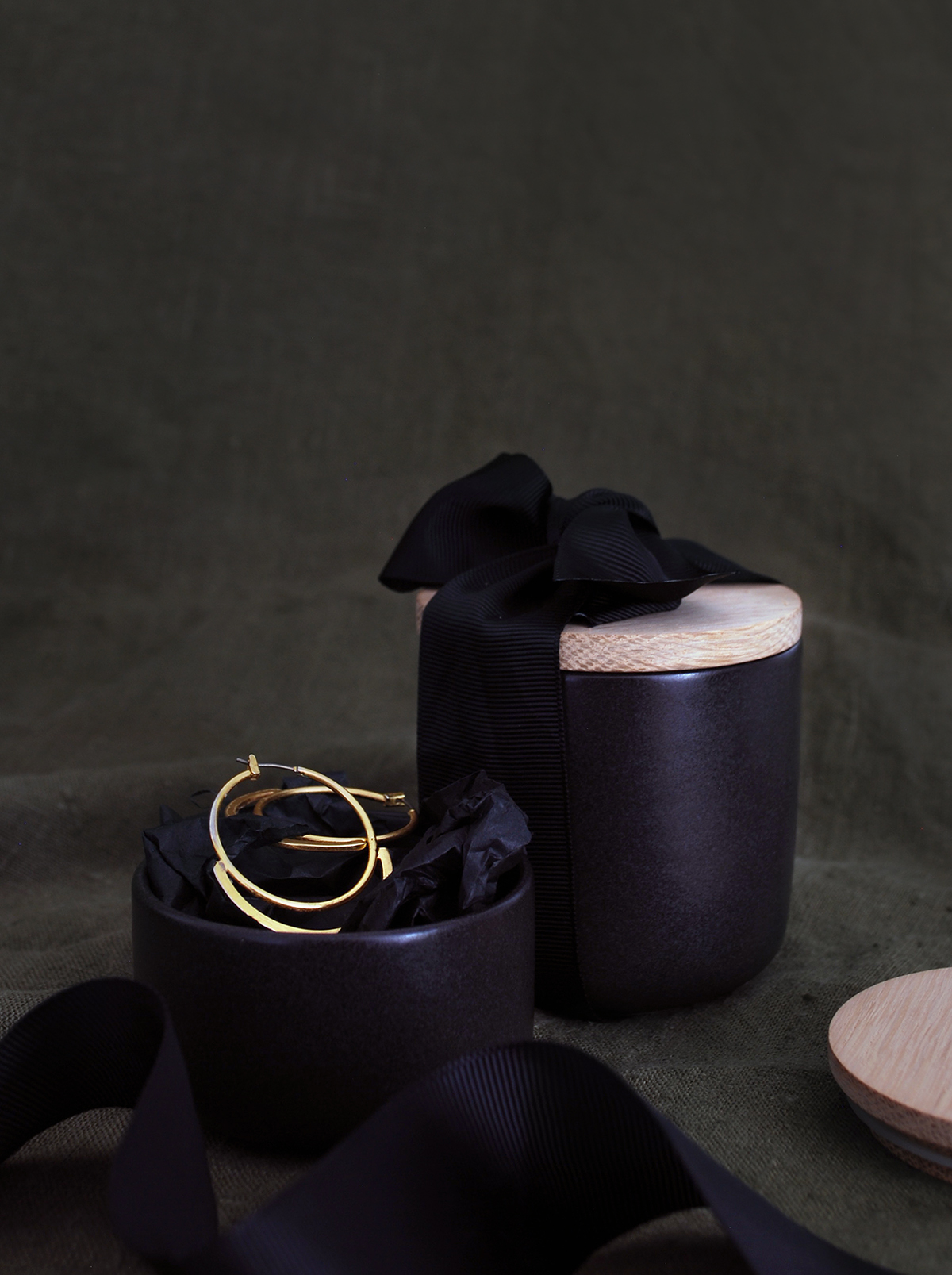 Simple ideas for extraordinary gift wrapping. Matte black kitchen cansiters look amazing tied with thick black ribbon.
