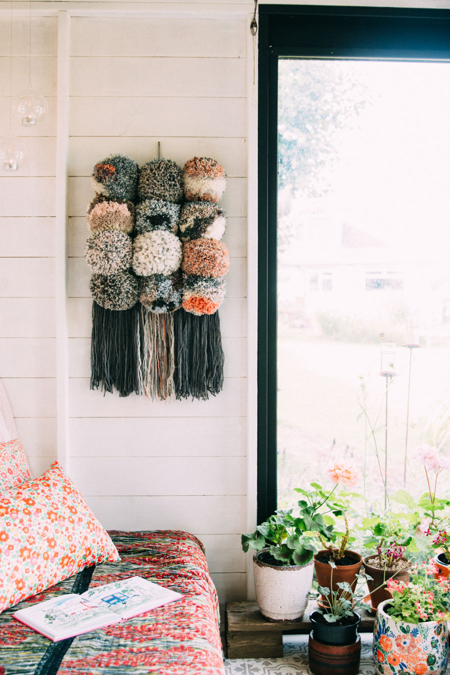 How to make a pom pom wall hanging. Tutorial by Lisa Tile for We Are Scout. Photo by Jeska Hearne of Lobster and Swan