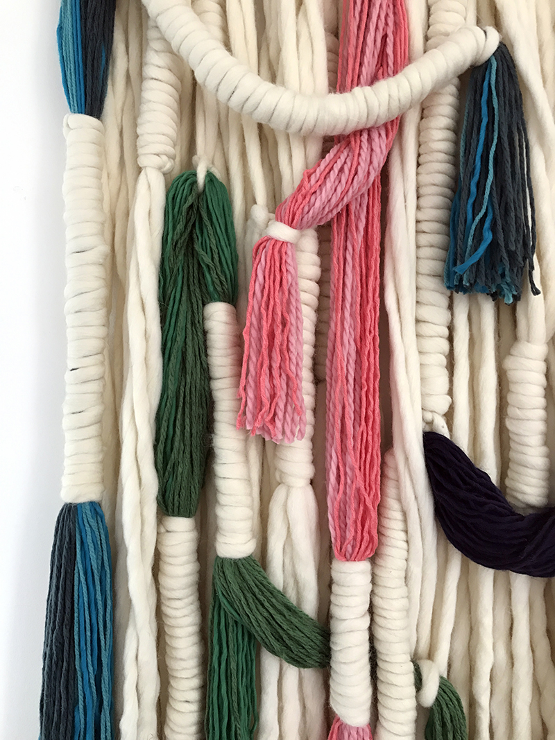 Make this amazing wool wall hanging
