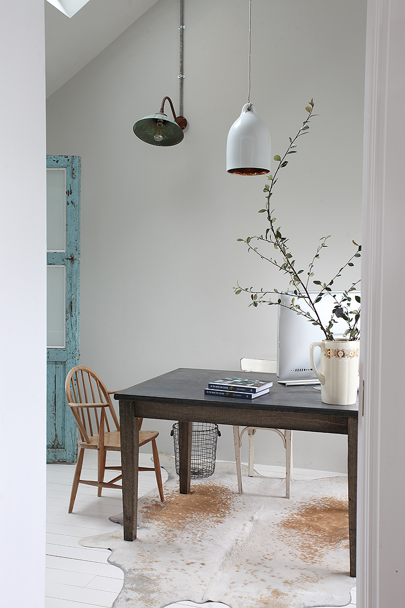 Love this sparse but warm office in a modern bohemian home