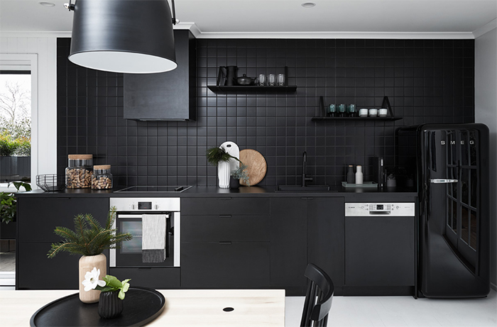 All black kitchen in a monochromatic Scandi style holiday home