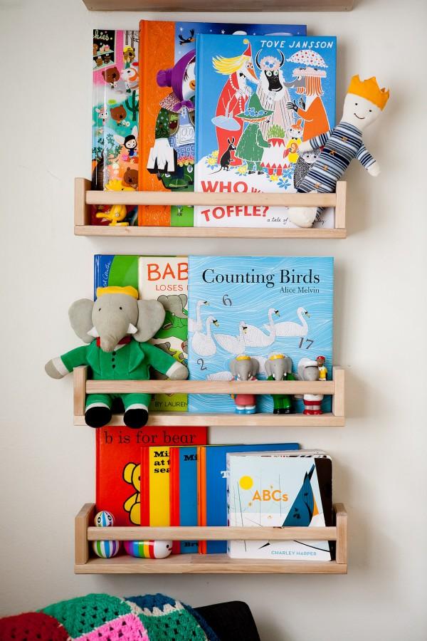 Children's book shelf using IKEA spice racks via we-are-scout.com